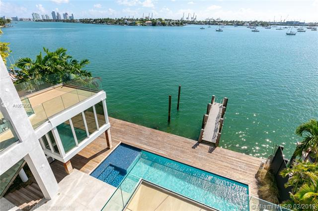 **Phenomenal Opportunity At A Significantly Reduced Price For The Right Luxury Buyer**<Br /><Br />Natural Light Floods This Truly Extraordinary Oversized Wide Waterfront Residence On Prestigious Venetian Island. New Home With Exceptional Details Throughout, This Home Features A Sleek Modern Open Floor Plan, High Ceilings, Large Living And Family Room. Private Elevator Fully Equipped Gourmet Kitchen, Summer Kitchen, Private Roof Infinity Pool, Guest House, Boat Dock, Wide Open Pool With Amazing Intracoastal View. The Two Huge Roof Decks Offers 360 Degrees Of Stunning Skylines View.