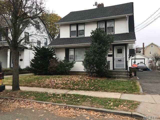 Great Investment Property, Legal 2 Family, Home, 1st Floor Unit Features, 2Brs, Living Rm W/Fireplace, Eik, Full Basement. 2nd Floor Unit, 2Brs, Eik, Lr, Full Walk Up Attic. Large Backyard 150Deep. Located Within Few Blocks Of Lirr, Schools & Shopping.