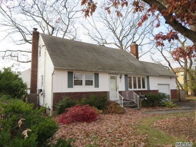 Now Is Your Chance To Get Your Foot Into Nassau County Suburban Living! A Great Deal Within A Great Town & School District! This Cape Cod Offers You 4 Bedrooms, 2 Full Bathrooms, Kitchen W/ A Formal Dining Room, Living Room With A Wood Burning Fireplace- Just In Time For These Cold Winter Months- A Full Basement, Attached Garage & Nice Sized Backyard. Bring Your Imagination Because The Potential Is Here!