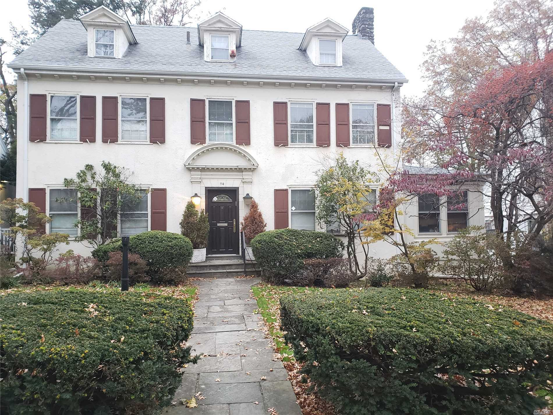 One Of A Kind Large Central Hall Colonial With High Ceilings In Prime Location Of Kew Gardens. Foyer W/Big Closet, Large Living Room W/Fireplace, Dining Room, Spacious Eat In Kitchen, Office With Custom Built In Furniture And Fireplace, Master Suite Plus Additional 5 Bedrooms And 4Bathrooms. Sun Room. Lots Of Storage Space. Font Yard, Large Back Yard, Detached 2 Car Garage. Excellent Location Near Forest Park, Lirr. Close To Houses Of Worship, Shopping, Dining, Transportation And More. Must See