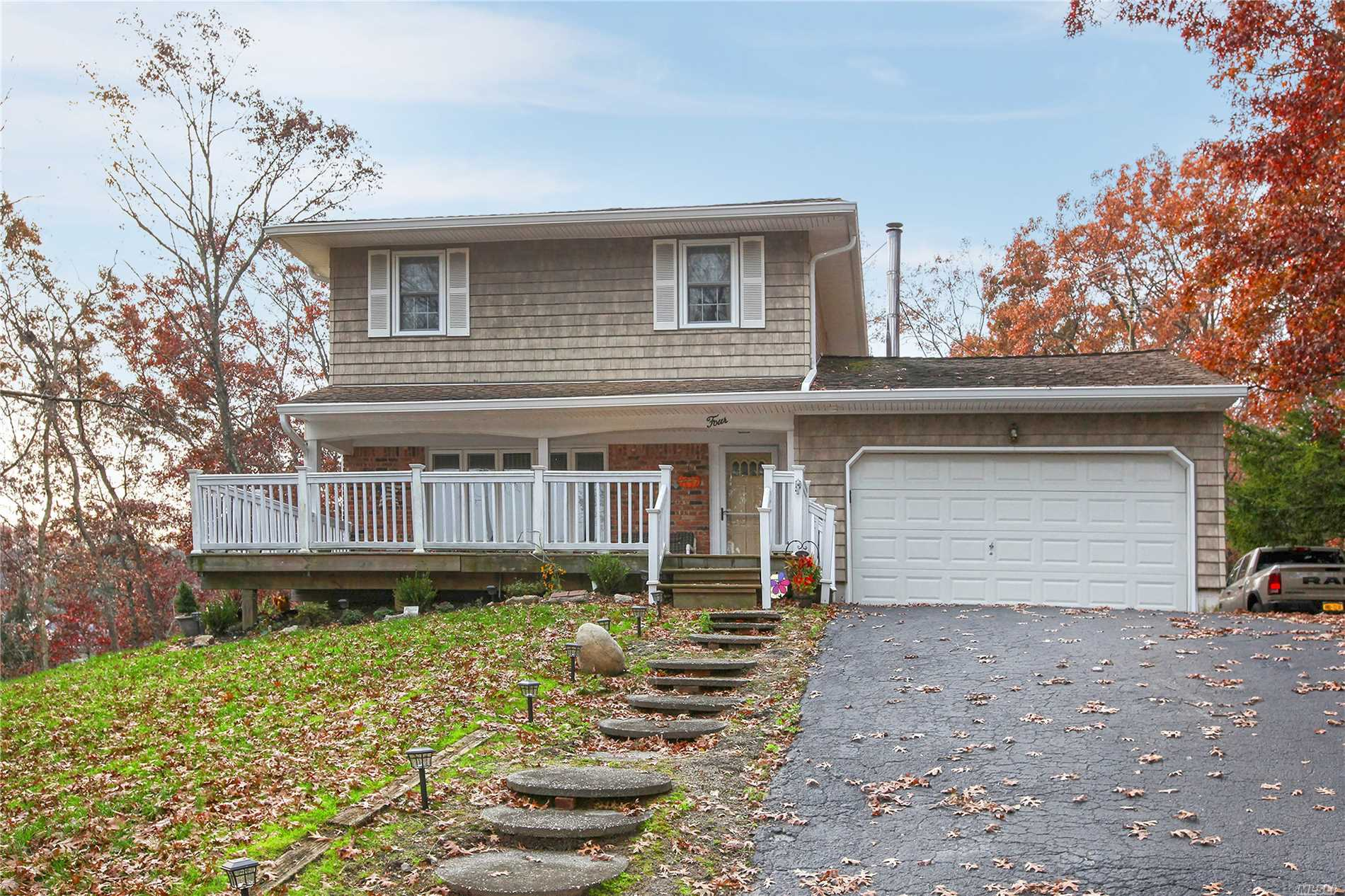 What A Beautiful Opportunity To Own A Well Maintained Home In A Highly Desirable Commack Community. This 4 Bedroom 2.5 Bath Colonial Offers A Newer Tiled Foyer And Kitchen Area, New Kitchen With Shaker Cabinets, Granite Tops, Tiled Backslash & High End Ss/Appliances. Large Sunken Den With A Stone Faced Fireplace, Cac & Solar Panels. Enjoy Your Summer Days In A Screened In Patio Or On Your Back Deck Over Looking A In The Ground Pool. All This And More All Situated On Over A Half Acre Of Property.