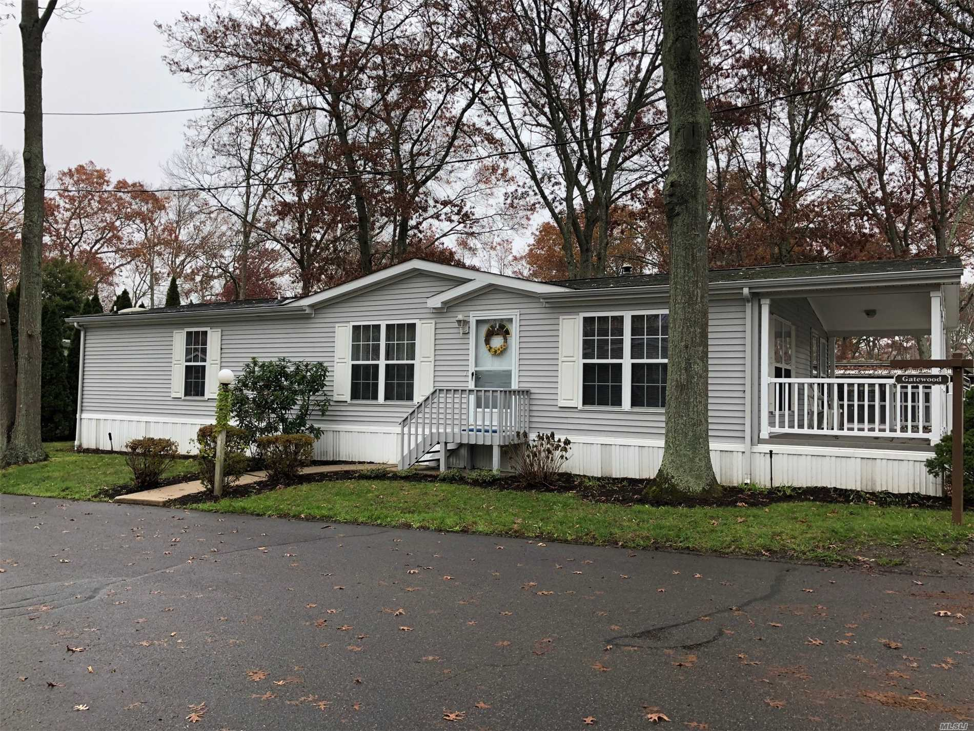 Spacious 2 Bedroom 2 Bath Home With Handicap Ramp - Large Front Porch And Deck Area - 2 Car Driveway And A Short Walk To Clubhouse And Park Area.