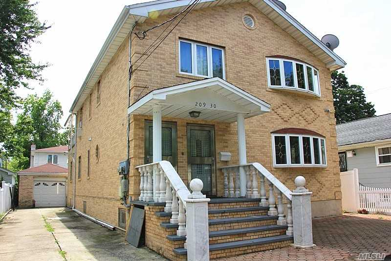 Beautiful Detached Two Family Detached Colonial Brick House W Detached Garage At Bayside. Re-Built At Year 2005. Totally 6 Bedrooms 4.5 Bathrooms And Finished Granite Basement Floor With 4 Sep Entrances. 2 Boilers And 2 Heaters. 26 School District With P.S. 376/P.S. 031/M.S. 158/Bayside H.S. Closed To Northern & Bell Blvd, Walk To Lirr And Multi Buses: Q12/Q13/Qm3/N20G/Q27/Q31. Best School, Great Community And Convenient, R3A High Zoning And Low Property Tax.
