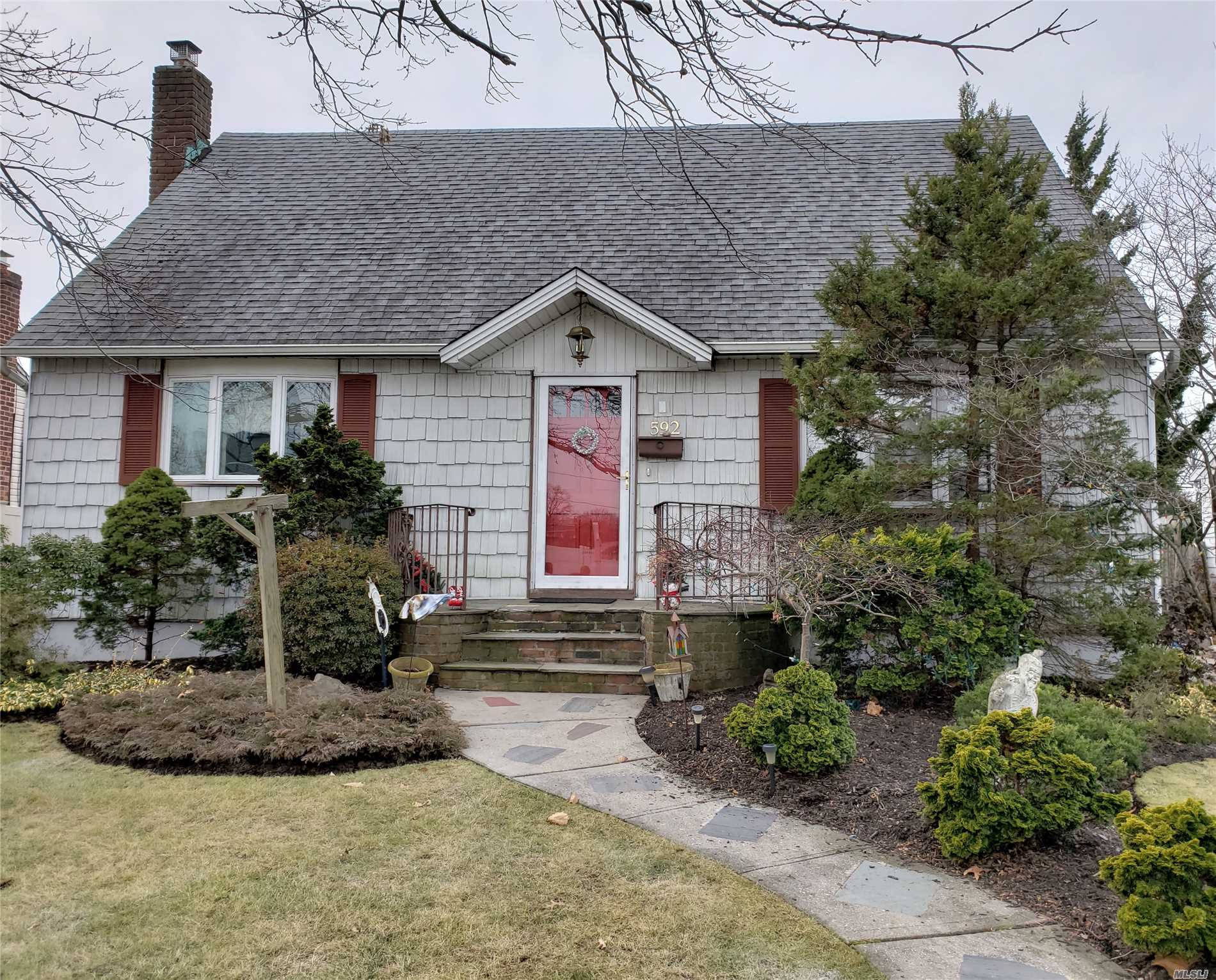 Lovely Expanded Cape Located Mid-Block On A Quiet Street. Featuring Expanded Eat-In-Kitchen With Sliders To Wood Deck. Mbr On 1st Floor, Formal Dining Room, Updated Bath With Laundry Shoot, Recessed Lights, Hardwood Floors. Gas Stove & H/W Heater. Finished Basement With Utility/Laundry Area. Detached 1.5 Garage With Overhang, Igs. Must See!