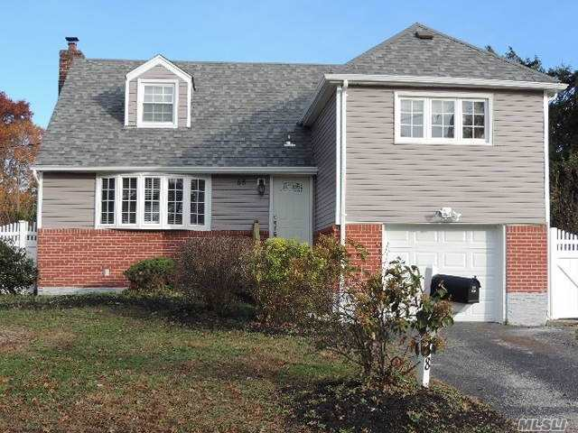 Beautifully Renovated Split In Bethpage! Suburban Nassau County At Its Finest! New Floors, New Tile, New Kitchen & Appliances, Pretty Updated Full Bath, The List Just Goes On! Lovely Back Porch In A Great Sized Backyard! Full Basement & Garage For Ample Storage As Well! Do Not Let This One Get Away!