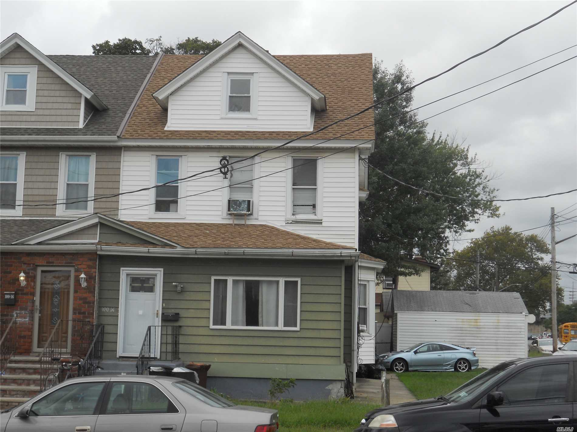 One Of A Kind Semi-Detached 2-Family House With Additional Vacant Lot (Possibly Buildable) Sold Together. House Lot Street Address Is 100-14 & Vacant Lot Is 100-12 With 2-Car Garage. Lot Size On Each 25X96. Zoned R3-2 (General Residential District). Full Unfinished Basement With Separate Outside Entrance. Near All With Easy Access To Lirr Trains, Cross Island Pkwy & Public Transportation. 2 Kitchens, 2 Baths, 4 Bedrooms Etc: