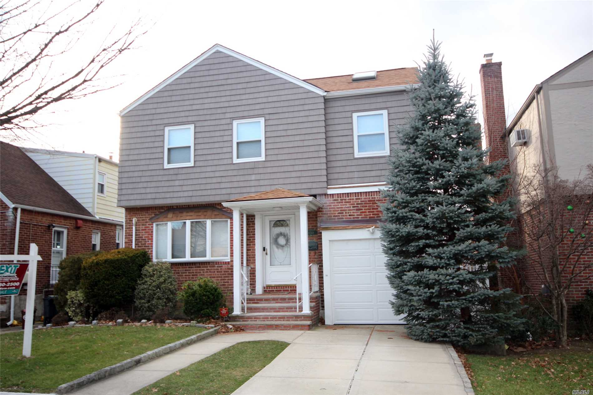 A Gorgeous, Totally Renovated Colonial House Located In The Heart Of Hollis Hills. The House Features Living Room, Formal Dining Room, Large Custom Eat-In-Kitchen, Large Den, 3-Bedrooms, One Bedroom Has A Stairs To A Mezzanine Style Room, 2.5 Bathrooms, Finished Basement With A Bath And A Laundry Room. In Addition, The House Has New Roof, Split Units In Every Room A/C And Heat, Updated 200 Amp Electric Wiring, 3-Skylights, New Siding, 'Smart House', Large Deck And 1-Car Garage. A Must See House!!