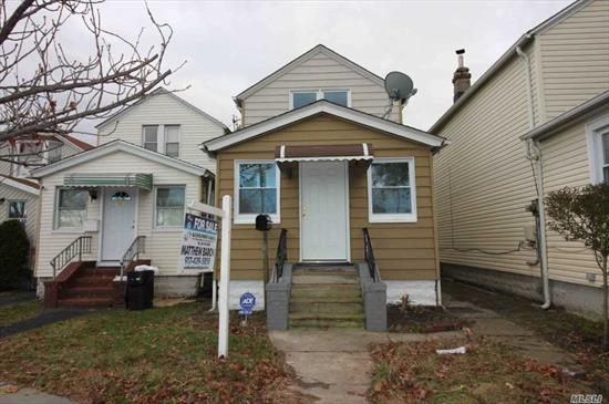 Renovated 1 Family Home Featuring New Windows, New Flooring, New Kitchen, New Bathrooms, New Plumbing, And New Electrical. Featuring 3 Bedrooms And 2.5 Bathrooms, Finished Basement, Community Driveway With Garage.