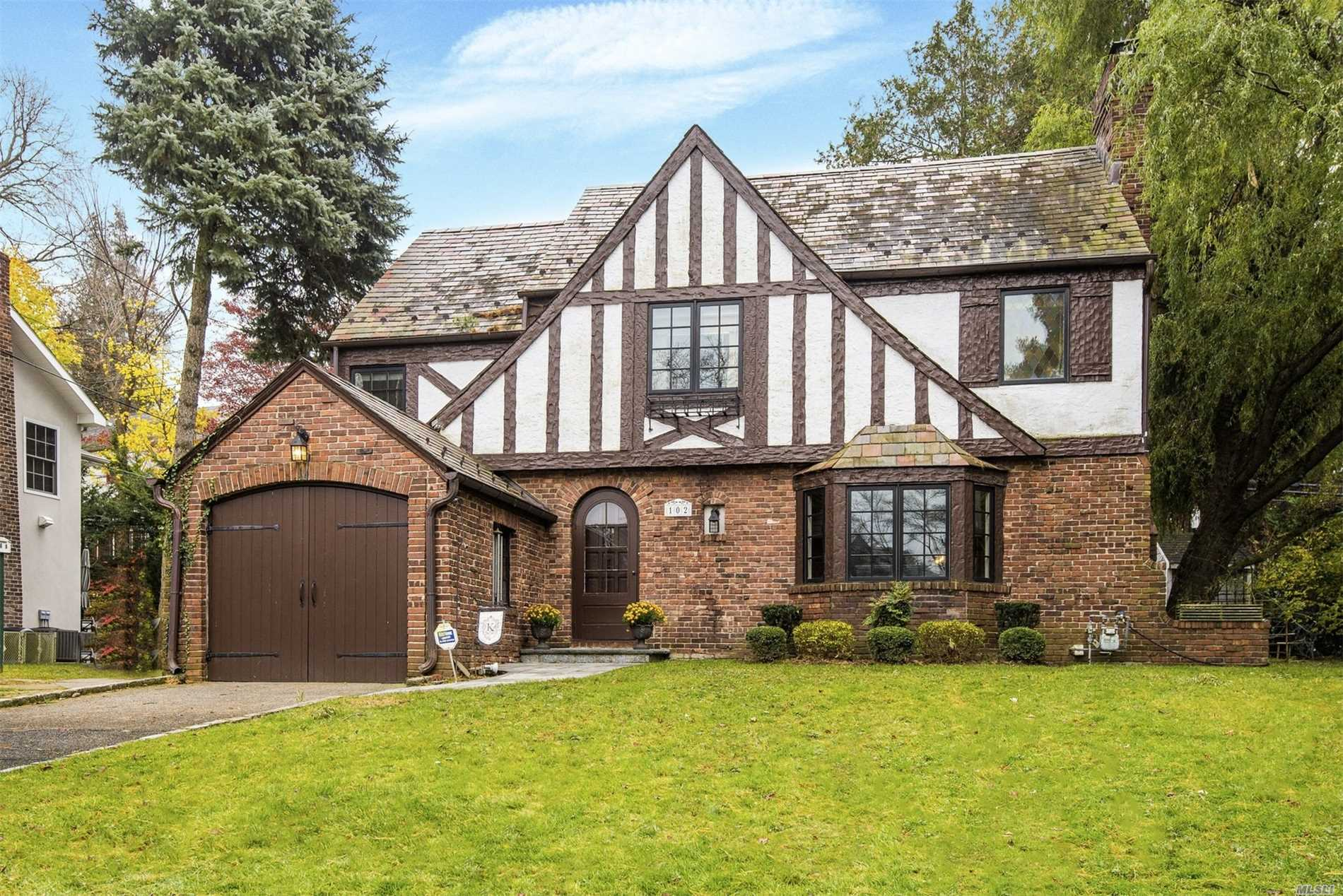 Set On A Quiet Street In South Strathmore, This Charming Meticulous Tudor Offers 4 Bedrooms, 2.5 Baths. Full Basement, Central Vacuum, New Blue Stone Patio W/Built-In Fire Pit. New Slate Roof, New Baths, Energy Efficient Marvin Windows. Munsey Park Elementary, Manhasset Middle/High Schools.