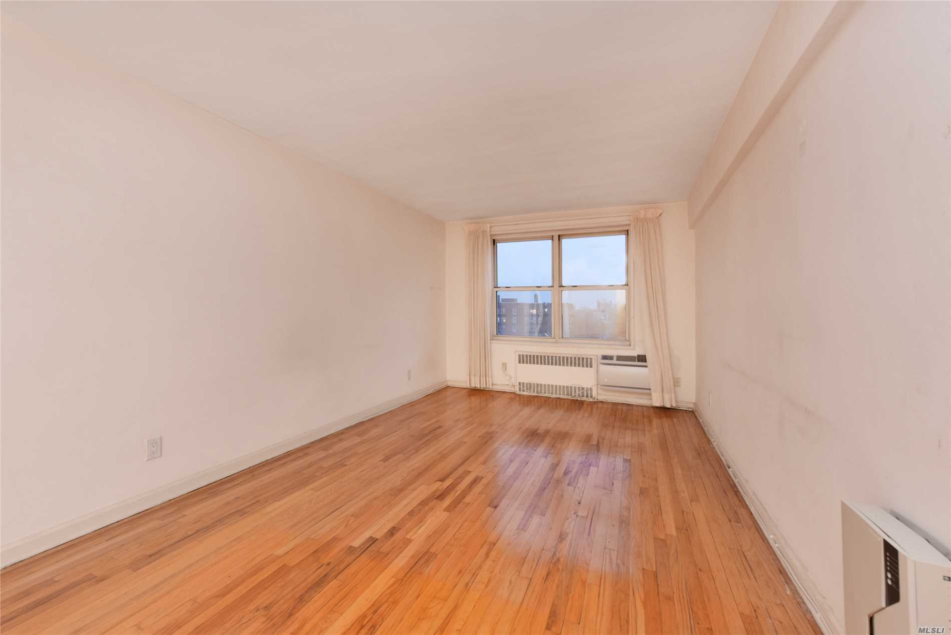 Large Spacious One Bedroom Corner Coop Unit On Top Floor, Estimate 800 Sf , New Finished Hardwood Flooring, South Exposure With Open View Of Downtown Flushing, Lot Of Closets, Formal Dining Area, Large Kitchen With Window And Updated Cabinets, Well Maintained Bathroom With Window, Dual Window In Bedroom, Quiet Court Yard Of The Complex, Gym, Laundry, Outdoor Gardens, Playground Close To Bus Line, Major Highways, Post Office, Library , Low Maintenance Including All Utilities, Owner Occupied No Sublet.