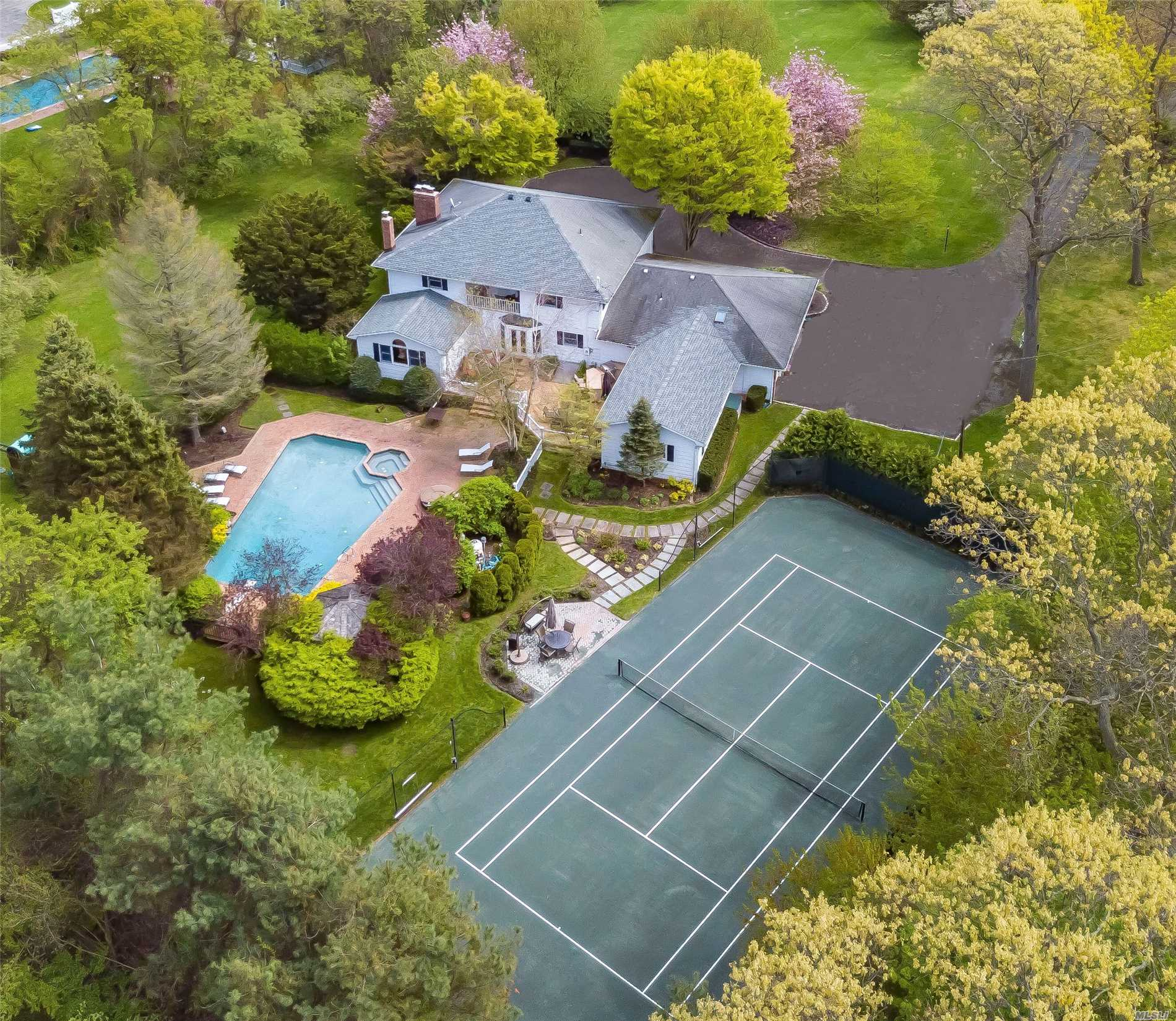 Tennis Lovers Paradise In Heart Of North Shore Gold Coast. Private Gated Drive Leads To Elegant Country Colonial On 2.4 Acres Of Lush Greenery With Olympic Heated Pool, Delightful Gazebo, Har-Tru Tennis Court, And An Outdoor Entertainment Area. New Kitchen With Top-Of-The-Line Appliances, Open Floor Plan, Three Room Separate Guest Suite. Reasonable Taxes. Full House Generator. Convenient To Miracle Mile & Transportation. Highly Rated Locust Valley S.D.