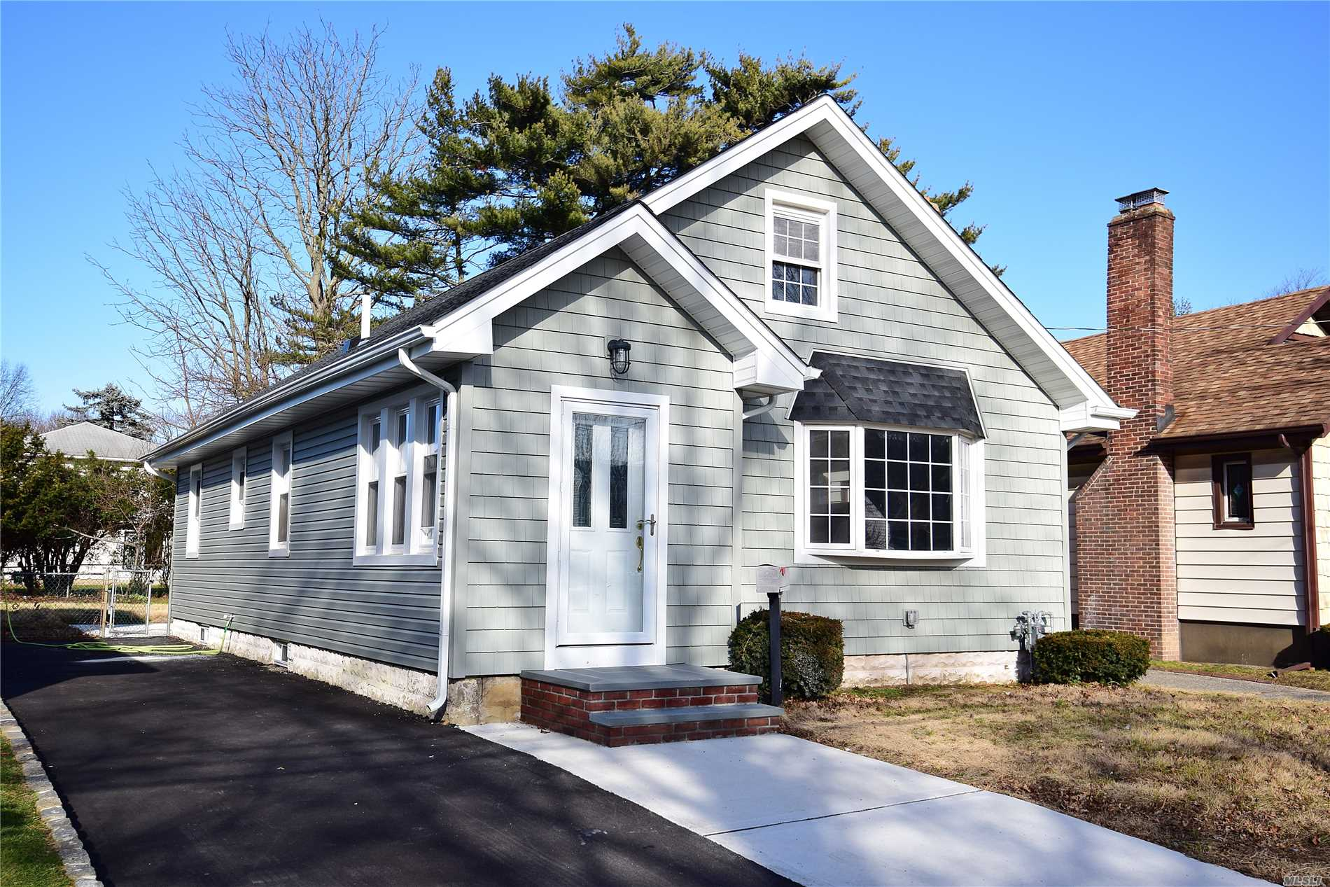 Charming 2 Bedroom Cape With Large Walk Up Attic. Completely Renovated, Hardwood Floors Throughout, New Eik With Granite Countertop And Stainless Steel Appliances W/ Breakfast Nook, Brand New Bath. Addt'l Updates Include, Plumbing, Electric, Roof, Siding And Windows.