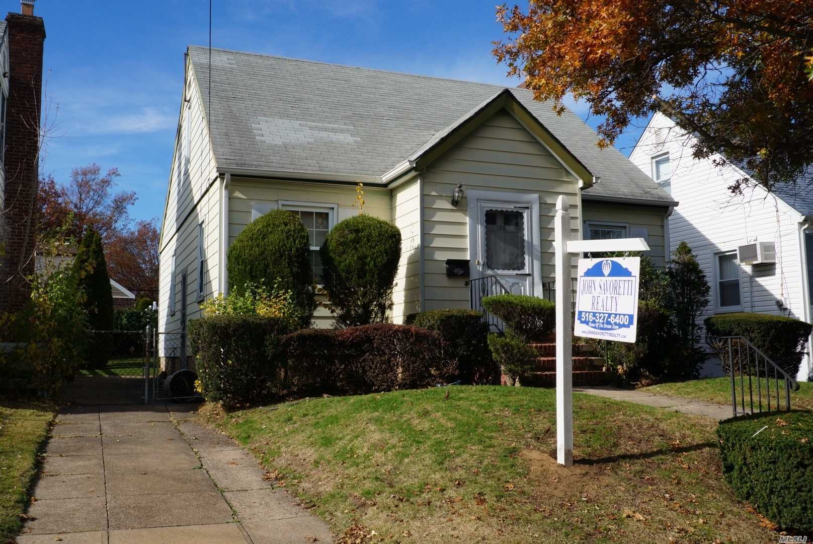 Beautiful Cape In The Heart Of Franklin Square. Located In The Presidential Section. School District #17 (Polk Street And Carey), Walk To Park , Shopping, Transportation And Worship. Hardwood Floors Throughout 1st And 2nd Floors . Must See ! Priced To Sell .