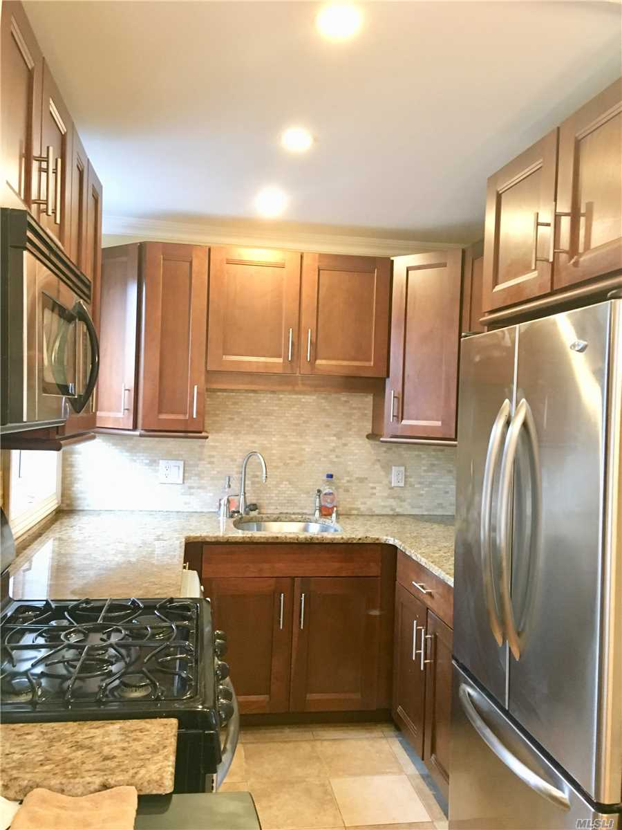 Corner Unit, Gorgeous Custom Renovated Kitchen, Beautiful Hardwood Floors, Custom Radiator Covers, Granite & Stainless Steel Kitchen, Close To Lirr, Close To Shopping