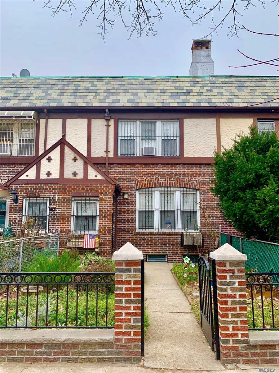 Beautiful Single Dwelling Brick House In A Convenient Location In Jackson Heights, Is Featuring A Large Lr With A Wood Burning Fireplace, A Formal Dr And The Granite Counter Top Kitchen On 1st Fl, 3 Bedrooms And A Full Bath On 2nd Fl, High Ceiling Finished Basement W/ A Full Bath, Family Rm, Att Garage And Sep Entrance. 3 More Parking Spaces At The Rear Yard. Close To Train, Buses, Convenient Shops & Schools!