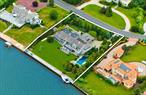 The Epitome Of Hampton's Luxury! Exquisite Contemporary Estate In A Phenomenal Waterfront Setting On Moriches Bay W/Unobstructed Views From Most Every Room & Generous Outdoor Spaces & Decks. The Ultimate Privacy On An Acre Of Pristine Grounds. Every Amenity & Upgrade Imaginable + An Incredible 186' Of New Bulkhead W/10' Mahogany Walk, High Tide Boat Lift, Jet-Ski Ramps, Wi-Fi System, Swim-Up Kitchen/Bar & Pool House With Indoor/Outdoor Showers. Truly A Family Retreat & An Entertainer's Delight!