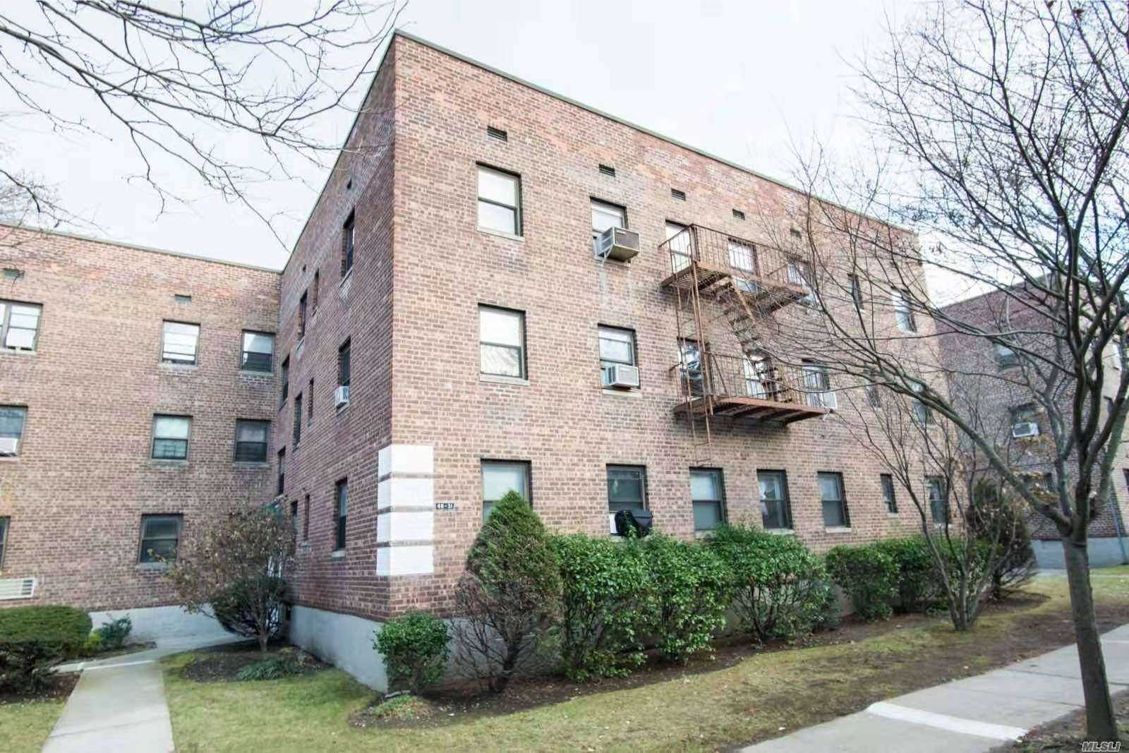 Very Nice 2-Bedroom Apartment On The 1st Floor. No Need To Wait For Elevator Or Climb Stairs! Featuring Wood Flooring Throughout And In Unit Washer & Dryer. Located On Tree Lined Streets Of Bayside In School District 26. (P.S.203, J.H.S.158, Cardozo H.S.) Near Bell Blvd & Northern Blvd For Supermatkets, Restaurants, Coffee/Donut Shop, Pharmacys, Banks, Library And Much More. Q12 & 27 Buses To Downtown Flushing.