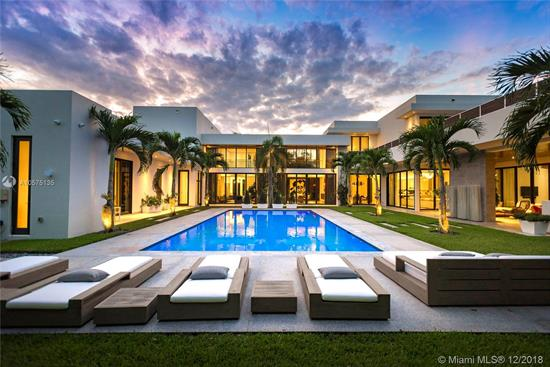 Designed With The Art Collector In Mind, This Unique Two-Story Modern Estate Spans A Generous 9, 855 Sqft And Includes 9 Bedrooms And 9.5 Bathrooms. Laid Out To Easily Communicate With The Spacious Guest House/In-Law Suite, Summer Kitchen And Outdoor Entertainment Area. Ideal For A Family Or A Multi-Generational Family. Master Suite Boasts Over-Sized His/Her Closets And Private Sundeck. Outfitted With State-Of-The-Art Smart-Home Technology With 20 Security Cameras, 24-Foot Ceilings, Floor-To-Ceiling Impact Windows, Stainless Steel State-Of-The-Art Wolf And Sub-Zero Appliances, Marble/Wood Flooring Throughout, 7 Seat Home Theater, 432 Bottle Wine Cooler, Private Elevator, 150Kw Generator And A Heated Infinity Edge Pool Sitting On An Impeccably Landscaped 37, 897 Sqft Lot.