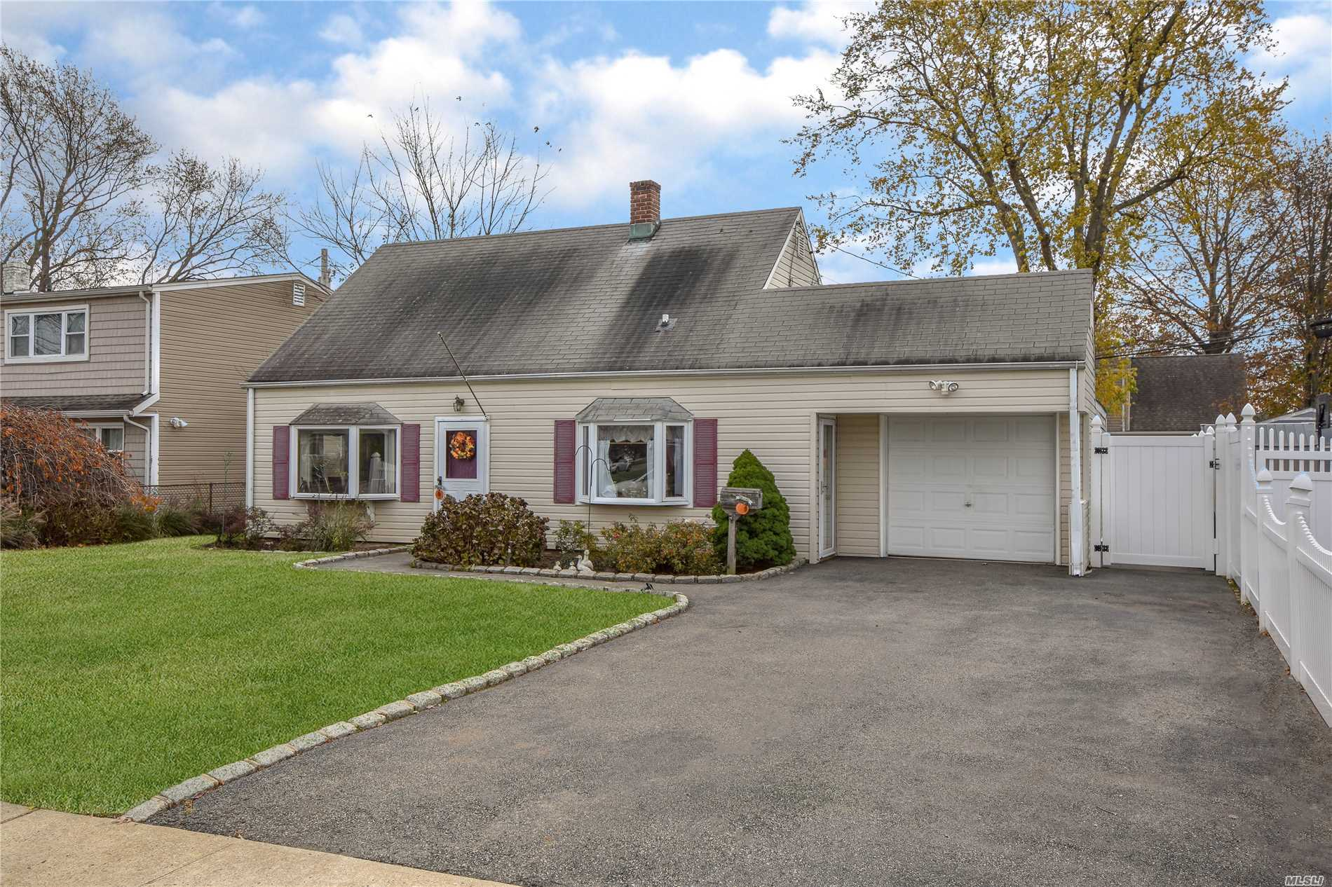 Nice 3 Bed 1 Bath Cape Cod Located In The Desirable Levittown Schools. Great 60X100 Lot , Make This Home Your Own, Great Location Close To All, Schools, Highways, Transportation, Spacious Eik, Living Room And Formal Dining Room. 1 Car Garage. Don't Miss This Awesome Opportunity At This Great Price With Low Taxes!!!...