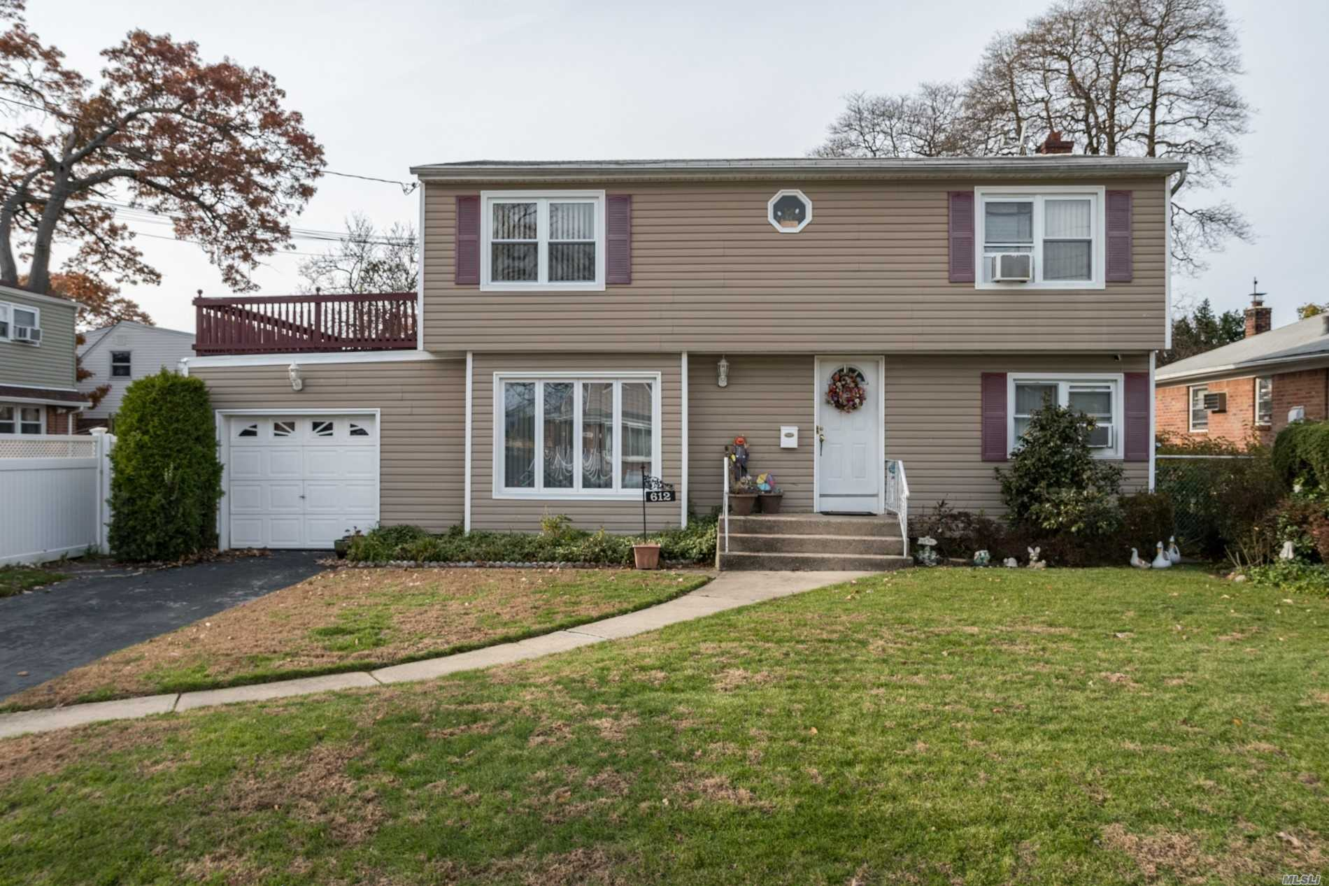 4 Bedroom 2.5 Bath Colonial Conveniently Located On A Culdesac In Elmont. Valley Stream Schools. Possible Mother/Daughter With Proper Permits. Great For A Large Family. Enclosed Yard And Private Driveway. 1 Car Garage And Finished Basement With Outside Entrance.