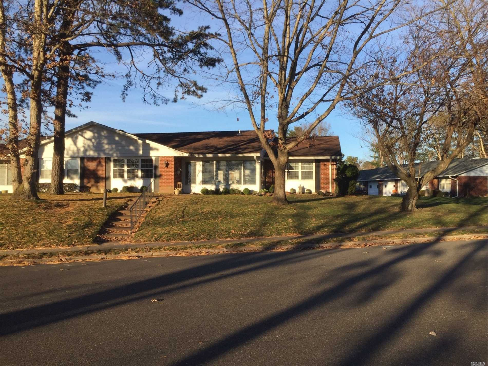 Big, Beautiful Corner Regency. Great Location With Extra Long Driveway That Parks Two Cars Plus Attached Garage And Lots Of Street Parking. 2 Bedroom, 2 Bath, Kitchen With Breakfast Bar Opens To Formal Dining Room. Living Room With Electric Fireplace And High Hats. South Facing Heated Sunroom. Country Club Amenities Include A 9 -Hole Executive Golf Course, Swimming Pool, Fitness Center, Bocce, Billiards, Dinner Dances, Community Lectures And Much More!