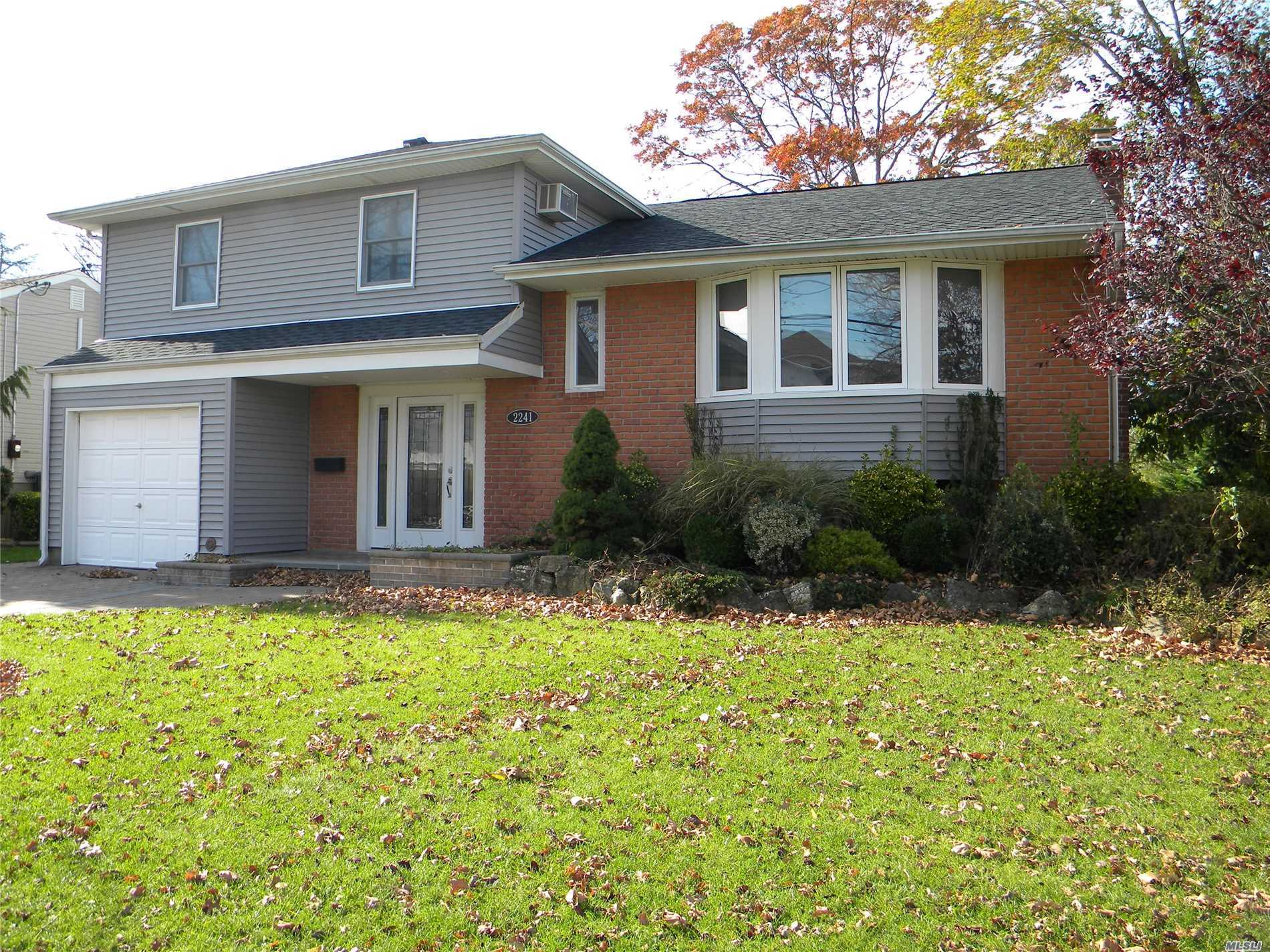 Beautiful Location! Flood Zone X.....Split Level Home With Large Great Room W/New Windows, Walls, Floors & 1/2 Bath. Mudroom Or Office.. Eik W/Ose To Deck, Fdr, Master W/Newish Fbth. Bsmt, Wood Floors, Paved Patio, Roof And Siding 8 Years Old, New Boiler & Washer/Dryer. Grievance Filed.