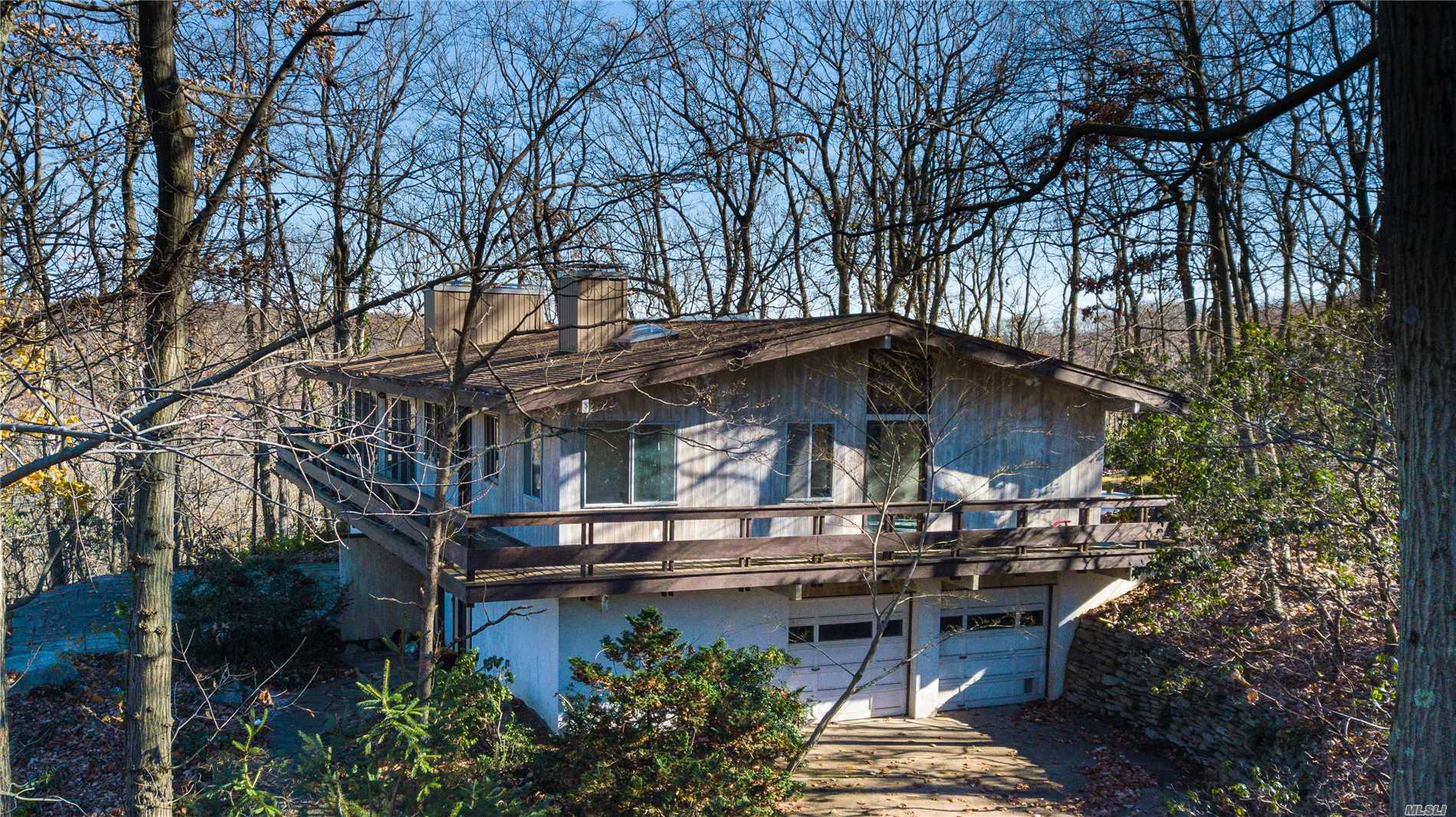 Rare Opportunity! 3+ Wooded Acres W/View Of Northport Harbor. Mid Century Post-And-Beam Inspired Home Designed By Noted Architect Theodore Bindrim (Garden City Hotel). Crafted W/Redwood & Floor-To-Ceiling Windows, This Serene Retreat Is The Ultimate Indoor-Outdoor Experience. Solidly Built W/Stunning Wood Beamed Cathedral Ceilings & Updated Kitchen. Recharge Your Soul In This Wooded Oasis W/Out Compromising On Boutique Shopping, Fine Dining, Outdoor Recreation, Railroad, Harborfields School.
