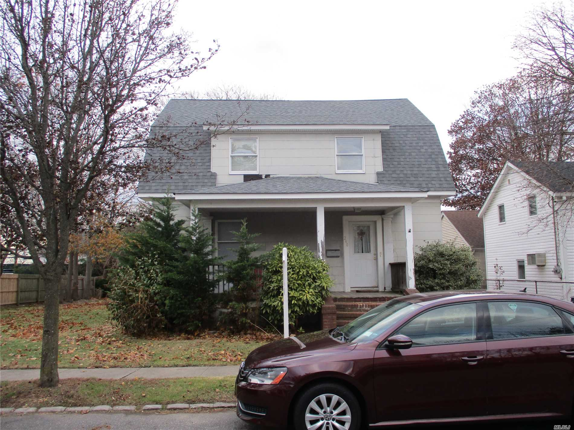 Two Family On Huge 80X150 Lot. Dead End Street In The Village Of Cedarhurst. Many Possibilities - Convert To A One Family, Continued Use As A Two Family, Possible Development Site. Two Car Garage.