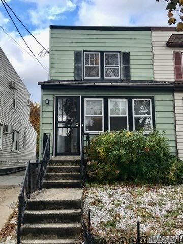 Handyman's Special!!! This Semi Detached House Has Tons Of Potential. R4-1 Zoning To Either Convert To A 2 Family Or To Make It Your Dream Home! Located In A Quiet Neighborhood, Walking Distance To Lirr Less Than 10 Minutes! Parking In The Back With A Beautiful, Flat, Clean Backyard!
