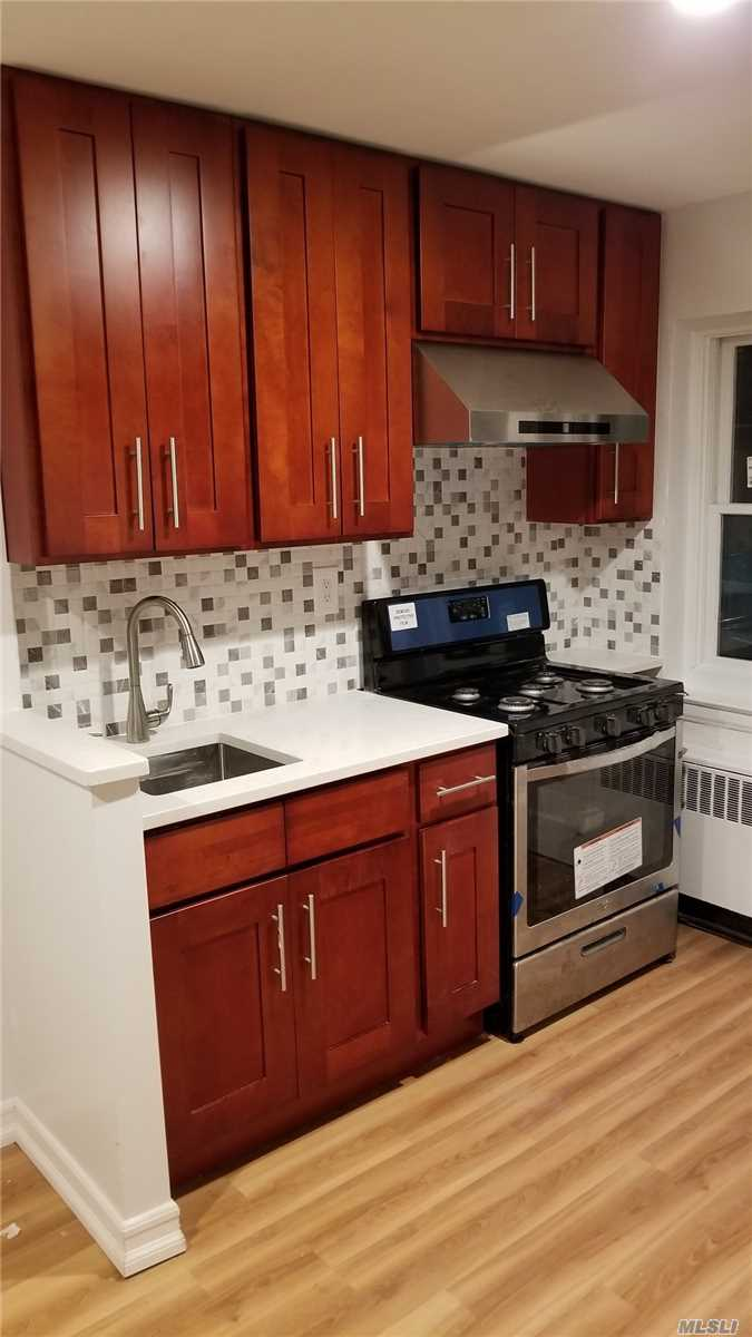 Beautifully Renovated, Cozy Large Bedroom With A Private Backyard. Brand New Windows, Living Room, Kitchen/Eik, And Full Bath. Garage And Parking Available At Additional Cost. Close To Park, School, Shops, And Public Transportation (Q17, Q88, Q65, Q25, Q34).