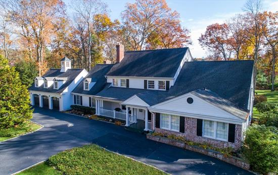 This Stunning Home Showcases Incredible Detail & Designer Finishes Throughout W/Large Principal Rooms & Dramatic Soaring Ceilings. French Doors Open To A Magical Outdoor Setting Perfect For Entertaining W/Covered Porches, Patios & Sparkling Pool. *Enjoy The Fabulous Outdoor Fireplace All Year Long*. A Rare Jewel Nestled On 2 Expansive, Private Acres.4Bdrm/4.5Bth Jericho Sd.