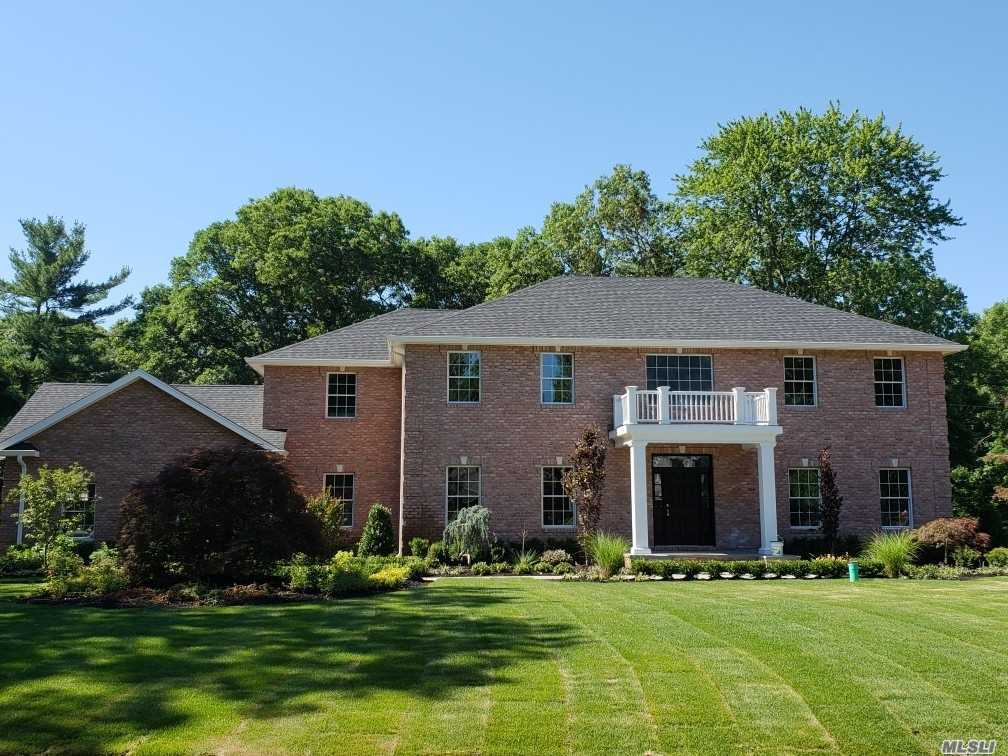 When Creativity & State-Of-The-Art Construction Meet Elegance & Sophistication The Result Is A Magnificent Masterpiece! Approximately 5, 000 Sq Ft, Center Hall Colonial - North Syosset On 1 Flat Acre! This Exquisite Home Blends Old World Charm W/ Modern Amenities & Classic Style! The Brick Front & Stunning Entry Welcomes You Into This One Of A Kind Home! 5 Bedroom, Eat in Kitchen, Formal Living Rm, Formal Dining Rm, Family Rm W/Fireplace & Coffered Ceiling, French Doors To Yard, 4 Full Baths & 1 Half Bath,  Fenced - In Yard...Berry Hill Elementary