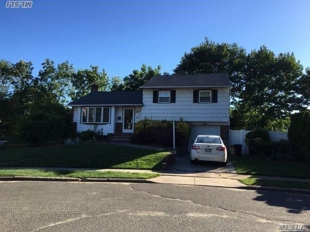 Updated 3Bedroom Large Split In A Desirable Area In Syosset. Walking Distance To Syosset Library, But Situated In The Middle Of A Quiet Street. Updated Granite Counter Kitchen, Wood Floor, Cac,  Large Wood Deck In The Nice Backyard, And Much More! Must See!