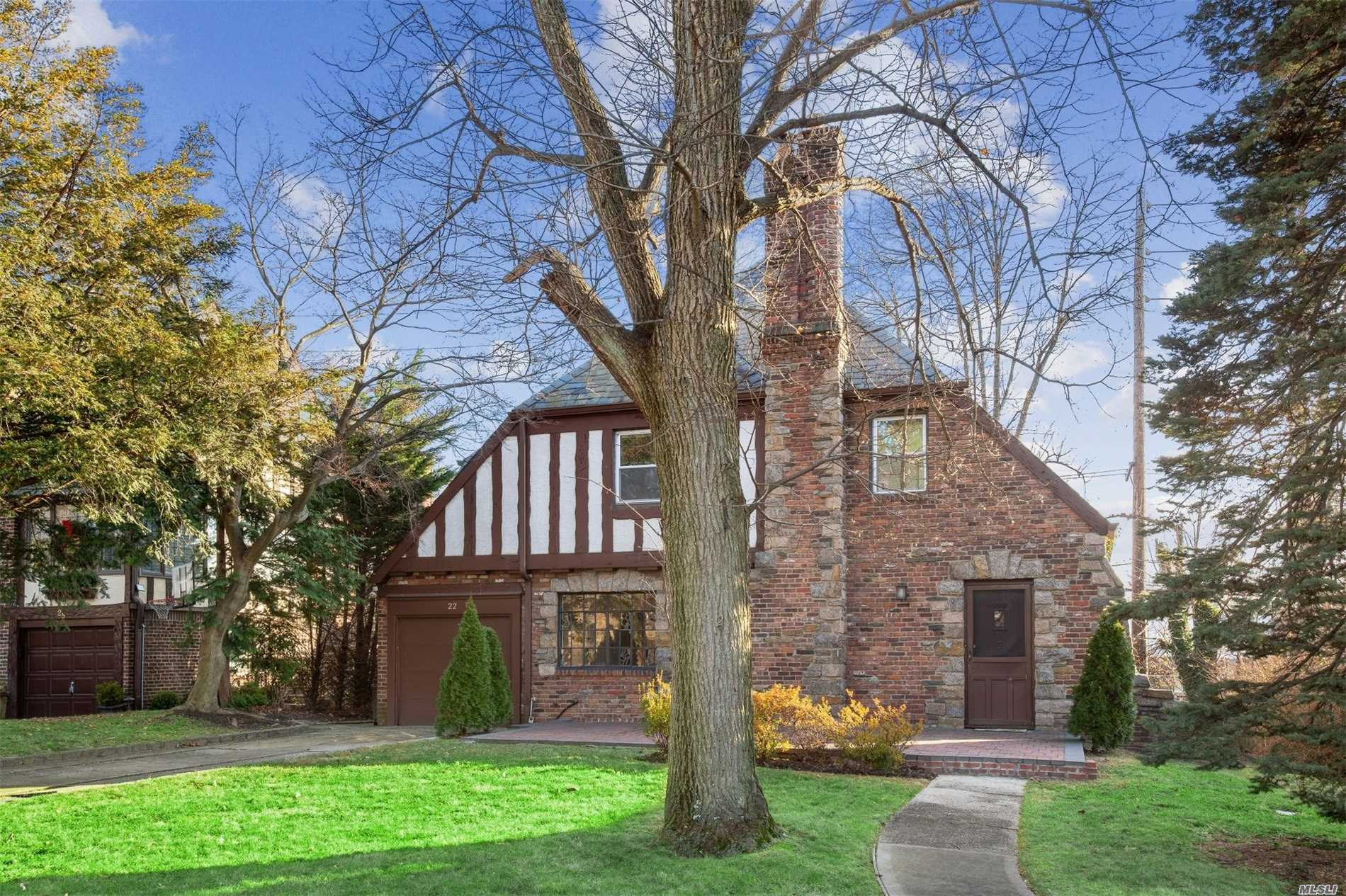 This Classic Brick & Stone Tudor Is Waiting For Your Personal Touch. Slate Roof, Orig Woodwork, Built Ins, Stone Fireplace & Wood Floors Throughout. 4 Bedrooms, 3 Baths, Family Room,  Walk Up Attic, 70X 132 Lot& Brick Patio All Add To This Homes Charm. Close To All..Shopping, Schools, 4 Blocks To Lirr. Munsey Park Elementary School