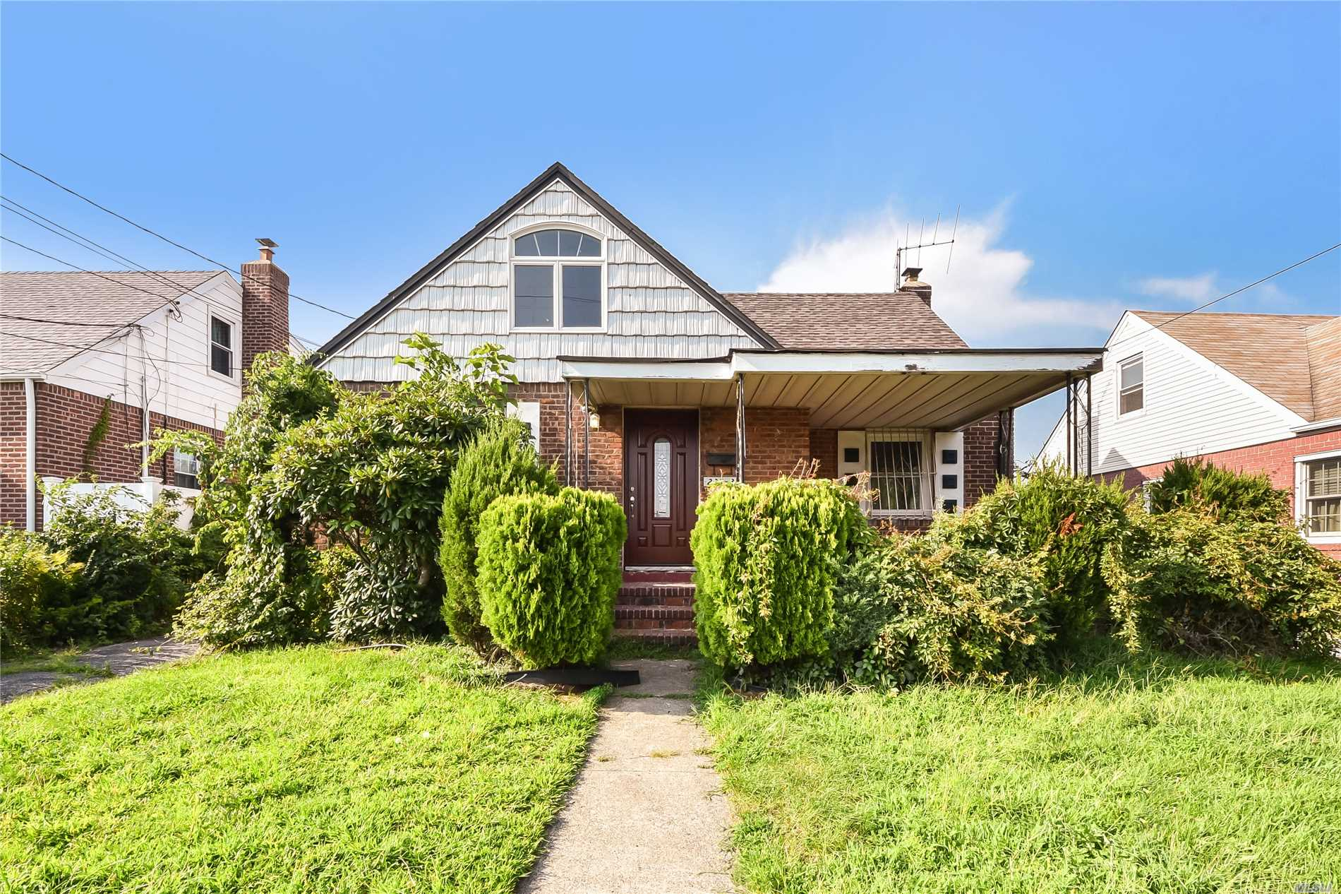 Elmont. Beautiful And Charming Newly Renovated Brick House With 2.5 Baths And A Finished Basement. Great Location. New Kitchen, New Baths, New Appliances, New Windows.
