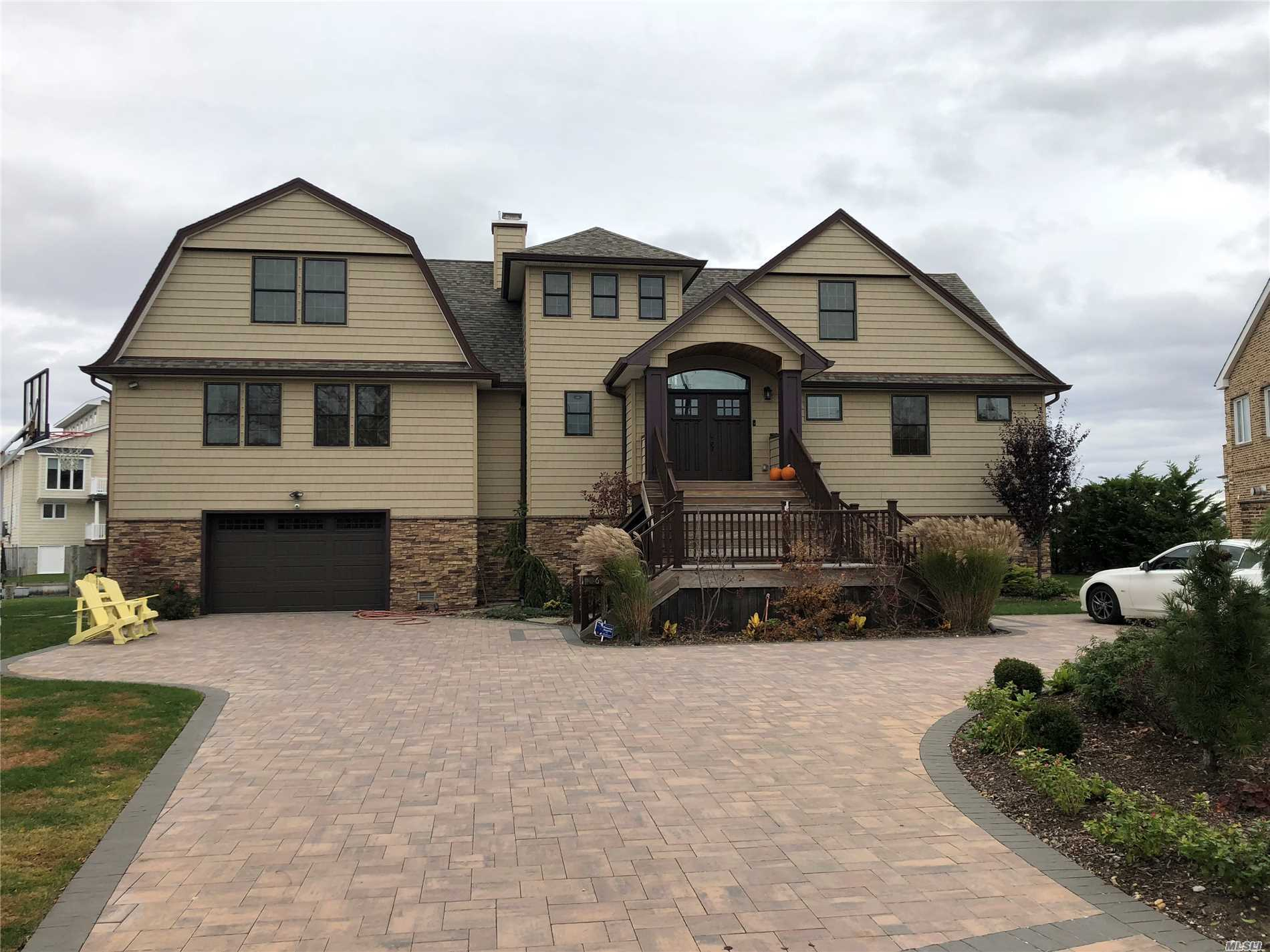 Enjoy Breathtaking Views Of The Great South Bay In This Lifted And Completely New Waterfront Home.. Deep Water Canal Protection With Open Bay Views! 130' Of New Navy Bulk Heading. Stainless & Granite Chefs Kitchen, Custom Baths, Main Floor Master Suite W Large Wic And On Suite Bath. Multi Level Decks. Large Circular Driveway. Inground Sprinklers, Custom Millwork Throughout. No Expense Spared On This Amazing Home. Make This House Yours For The New Year .