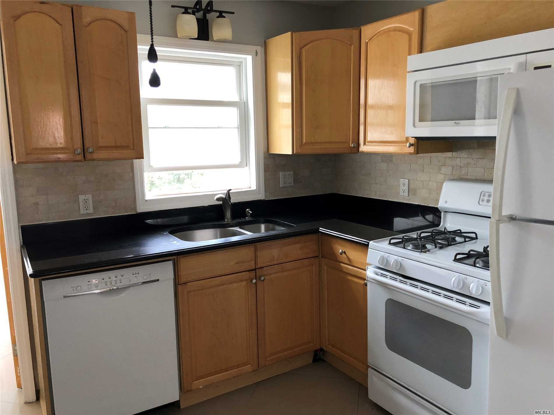 Mint 2 Bed 1 Bath Diamond Condition , New Kitchen With Double Sink , Porcelain Floors Throughout, 1 Car Pkg , Steps To Train And Stores And Beautiful Park