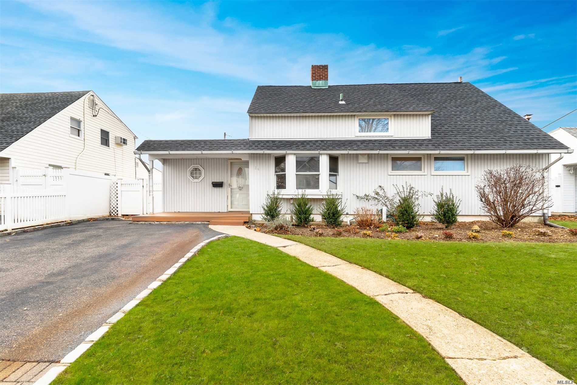 Location! Location! Location!  Lovely Cape Situated On A Perfect Mid-Block Location In The Desirable Area Of N. Levittown. This Warm & Inviting Home Boasts 5 Bedrooms, 1.5 Baths, Stainless Steel Appliances With Granite Counters, Dual Fireplace, 2 Skylights, Updated Windows, Led Lighting, New Roof, 2 Neighbors, & A Double Driveway. Close To Major Highways, Public Transportation, Shopping, Park, & Pools. A Must See To Appreciate. Taxes Have Not Been Grieved & In The Process Of Being Greived!!!!!