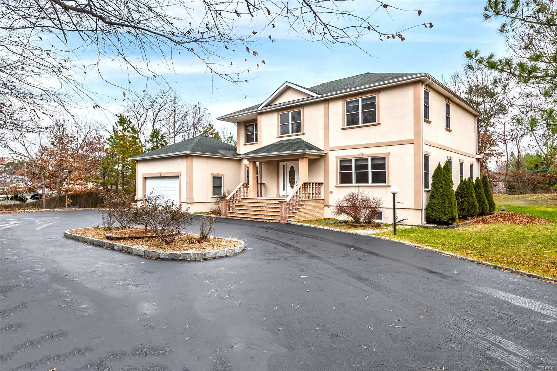 3712 Square Foot Colonial Tucked Away In A Private Area Of Lake Ronkonkoma. 4 Bedrooms, 3 Full Baths, Beautiful Hardwood Floors, Crown Molding, Freshly Painted, Large Rooms Through-Out. Gas Heating, Central Air, Large 2 Car Garage., Finished Basement With Outside Entrance. Sachem Schools, Close To Lie & Lirr