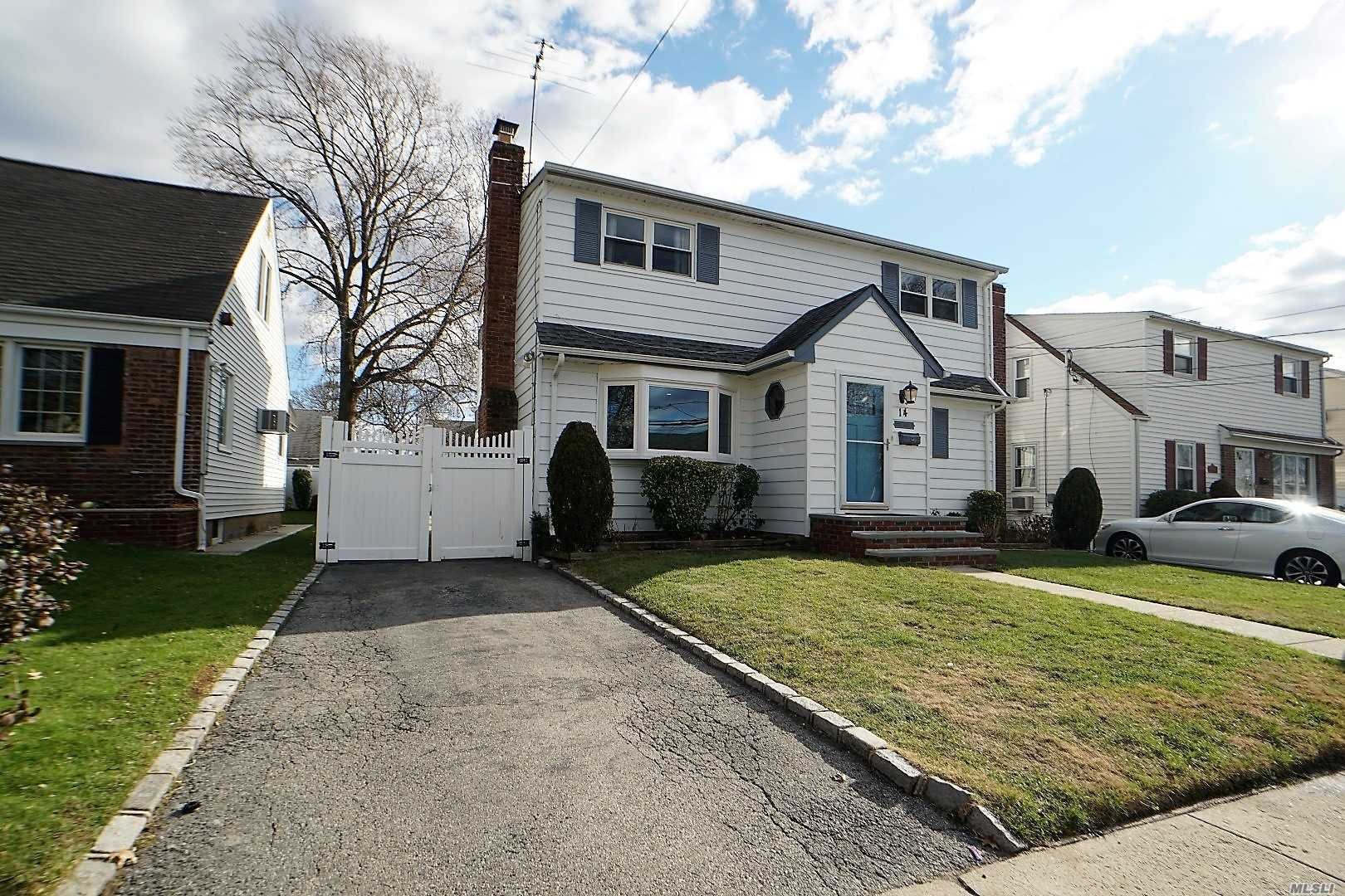 Generously-Sized 2 Story Beautiful Colonial Featuring A Full Finished Basement, 3 Bedrooms And 1.5 Bath. Open Concept Living Room Featuring A Magnificent Classic Brick Wood Burning Fireplace And Grand Bar. The Backyard Features A Cozy Cement Patio, Dollhouse Like Shed And An Extended Driveway With More Than Enough Room To Play. Valley Stream School District. Close To Shopping, Public Transportation And Highways.