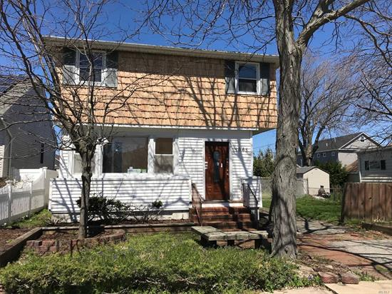 Two-Story Colonial, Features Open Floor Plan W/Spacious Living Room, Dining Room, Enclosed Porch, Kitchen, Laundry Room, 5 Bedrooms, 2 Bathrooms And 1 Car Garage. Partial Basement. Sits On Quiet Residential Street. Great Opportunity.
