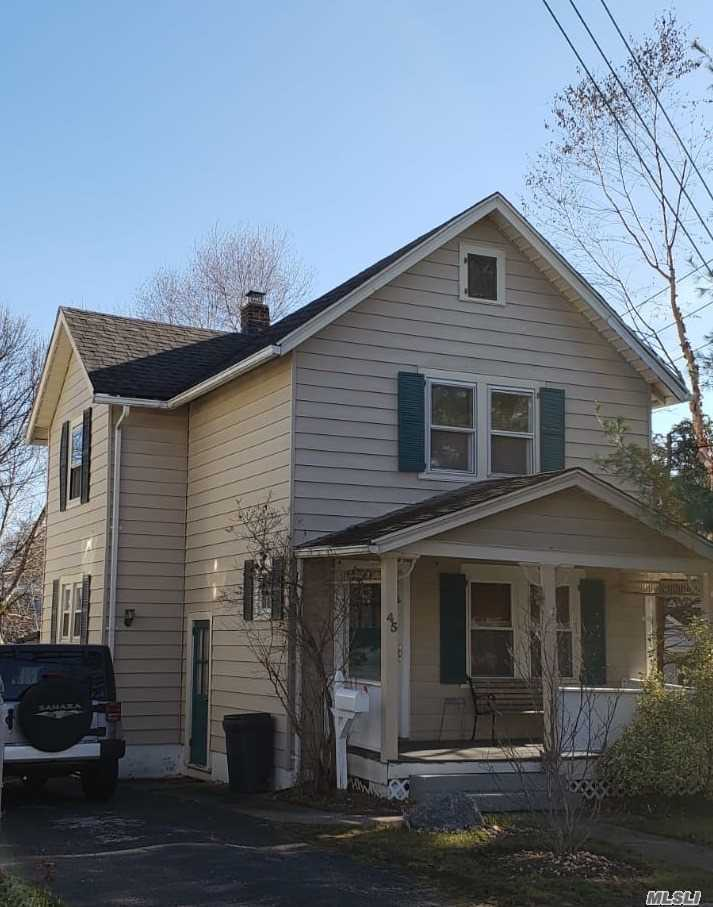 Charming, Cozy Front Porch Colonial. Walk To Lirr, Shopping & Restaurants. 3 Brs, 2 Baths, Living Room, Dining Room, Eik, Finished Basement With Ose, Cac And Hardwood Floors Throughout. Gas Cooking, Oil Heating, Private & Spacious Backyard.
