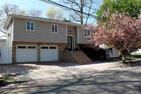 Nassau Shores Massapequa Totally Mint High Ranch 4/2 With Room For Mom. No Flood Insurance Needed (Flood Zone X) Brand New Custom Kitchen With Quartz Countertops And Stainless Appliances. Totally Open Floor Plan. Awesome Curb Appeal With Granite Steps W/ Paver Driveway And Yard. High End Marble Bathroom. Seconds From Marjorie Post Park And Burns. No Need To Even Buy A Paintbrush For This One. It's Mint!