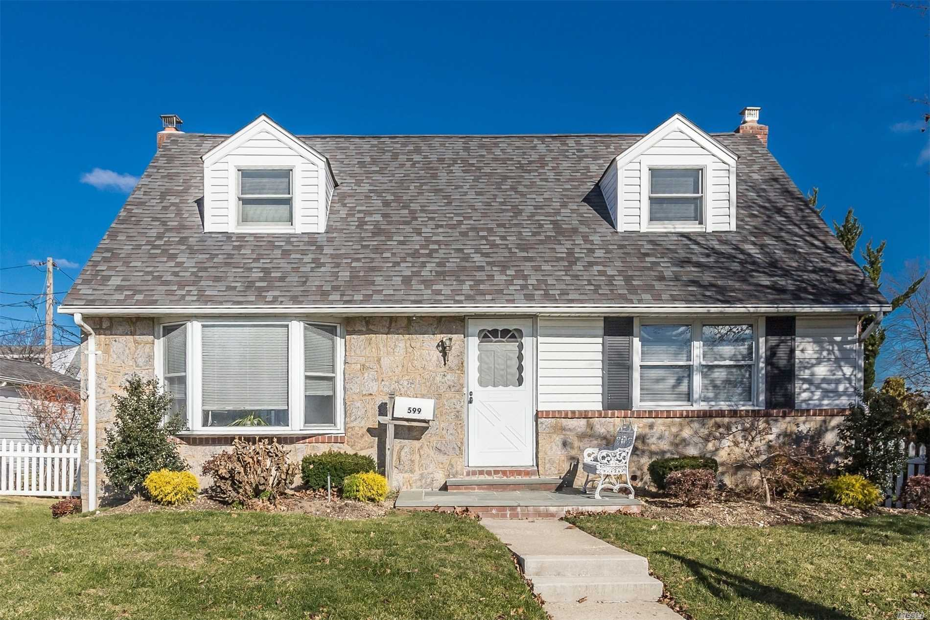 4 Br/3Full Bath Cape, Easy To Convert To Mother/Daughter. Newly Painted, Countless Updates, Cac, Inground Sprinklers, Full Basement With Beautiful Family Room W/Fp, Updated Electric, Detached Garage,  Trex Deck, Mature Fruit Trees, Lovely Landscaping. Low Taxes! Must See!