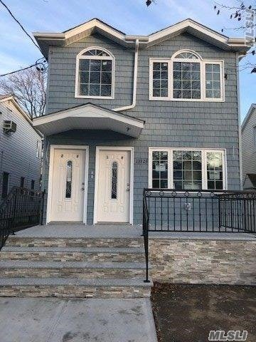 Huge Two Family Det, Hi-Ranch, 6/6 Rms, 5 Fbth, Pvt Driveway & Garage. Completely Redone Like Brand New. Custom Kitchens & Baths, Hardwood Floors, Two Boiler & Two Hot Water Tank.