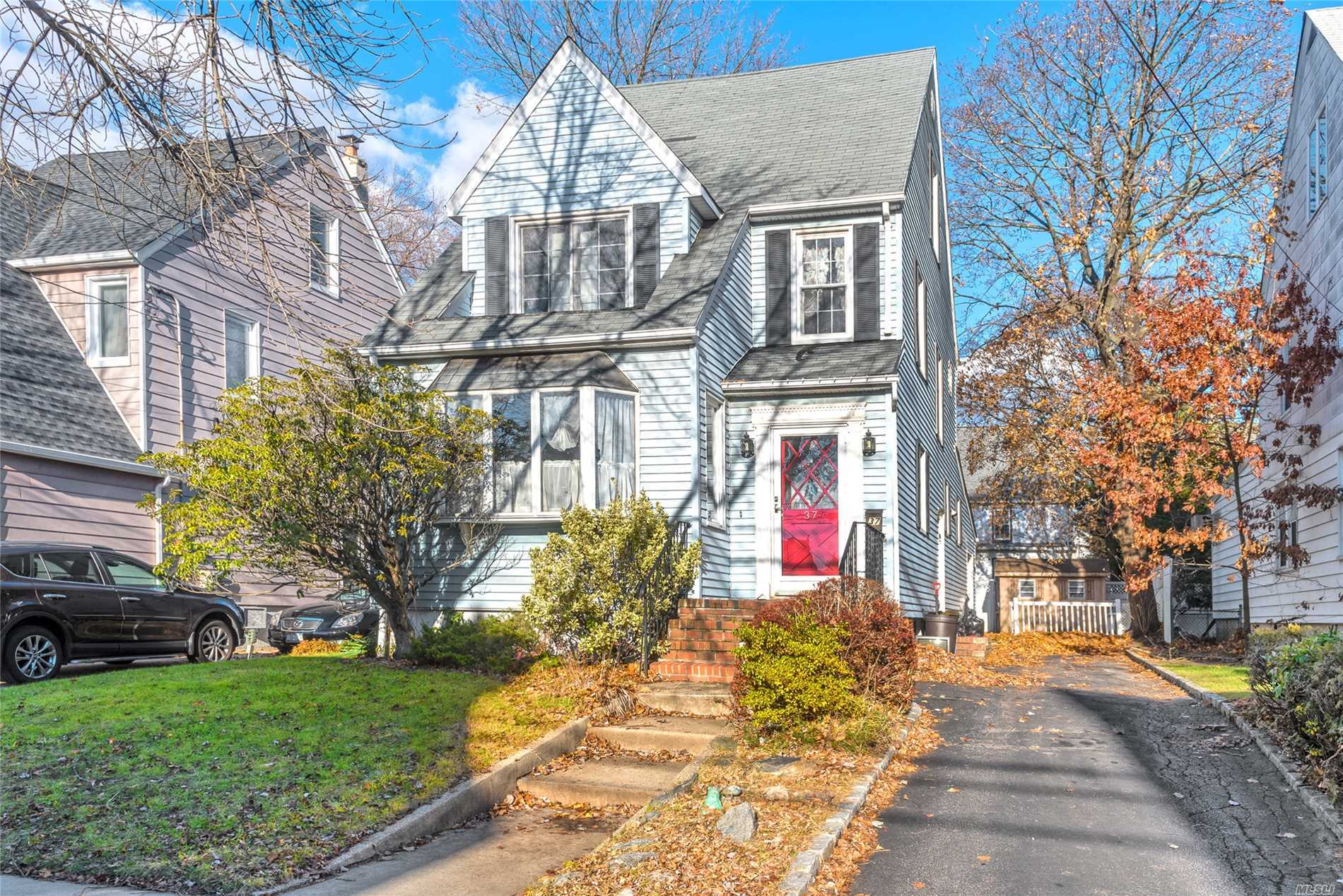 Great Large Expanded Gibson Colonial With Hardwood Floors Thru Out, Large Sunken Den Off Kitchen, Banquet Size Dining Room. Seconds From Lirr, Bus, Shops And Park. Roof, Windows, Siding And Heat Are Updated