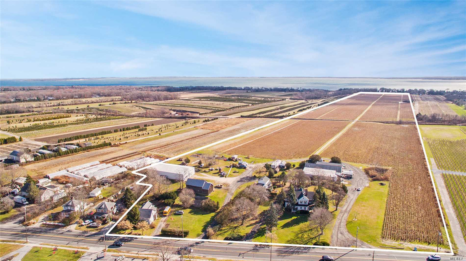 Sale Includes All 4 Lots, Must Be Sold As One. (Res.)48-03-11.00 = Taxes $13, 646.92/10.7 Acres, (Res.)48-3-10.00 = Taxes $26, 693.85/11.5 Acres, (Land)69-3-56.00 = Taxes $13, 700.42/24.5 Acres, (Land)69-3-57.00 = Taxes $8, 394, 32/24 Acres. (Res.)48-03-11.00 & (Land)69-3-57.00 = Mattituck/Cutchogue School District. (Res.)48-3-10.00 & (Land)69-3-56.00 = Riverhead School District. Land - Zoned Ra80, Residential - Zoned Rb80. Same As Mls# 3085060.