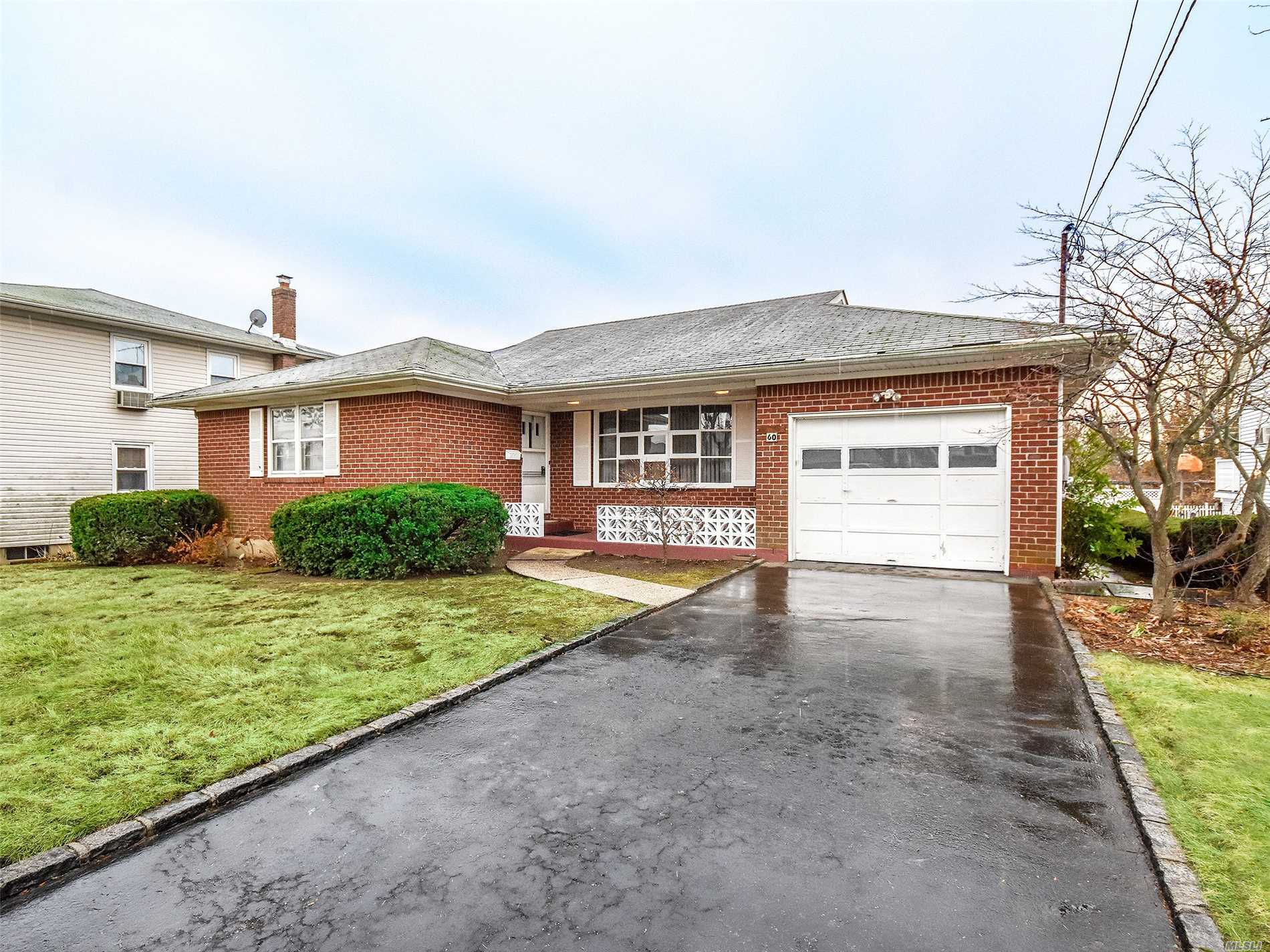 Beautifully Redone 3 Br Ranch With New Hard Wood Floors In Bedrooms, Hall And Living Room, Spacious Eik W/New Tile Flooring, Pantry And Door To Large Covered Porch , Basement W/Ose , Storage, New Washer/Dryer.  Close To Village, Schools, Beaches Golf , Railroad And Main Roads