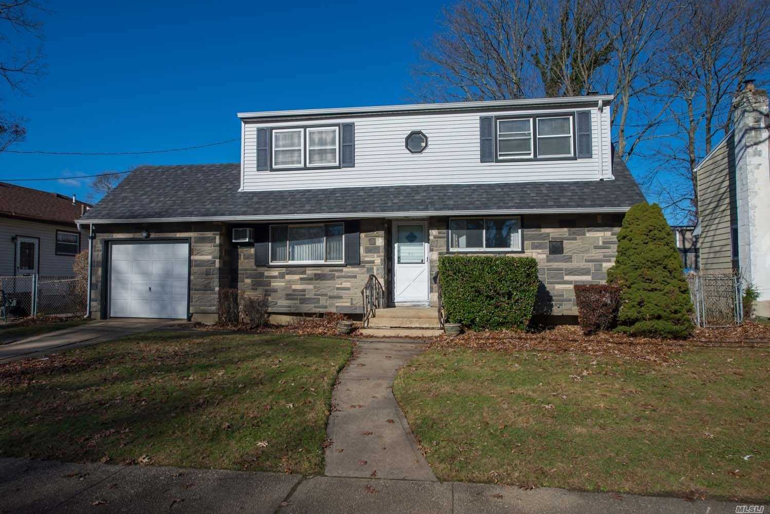 Fully Dormered And Expanded Cape Cod Home With 1800 Sq. Ft. Of Living Space Featuring 5 Bedrooms And 2 Full Baths In The Heart Of Massapequa Park! Kitchen And Baths Have Been Updated! Den With Sliders To Yard! New Oil Burner And Tank! 8 Yr Old Roof And Updated Electric!Location Is Everything In This Diamond In The Rough Home!Birch Lane School!Apply Your Own Taste & Move In!Taxes W/Star Under $10K!Sold-As-Is!