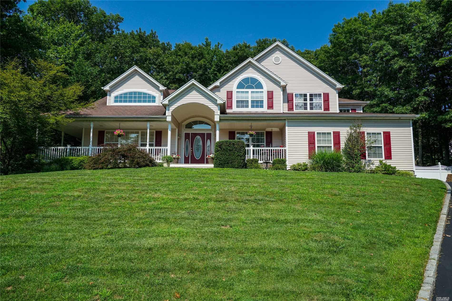 Desirable Cul De Sac Location In This Move-In Ready Post-Modern Colonial. Two Master Bedroom Suites In Addition To Two Other Large Bedrooms. Hardwood Floors, Central Vacuum And Air. Two Fireplaces. Large Eik With Family Room. Basement Has Large Recreation Room, Work Room And Office Area. Entertainers Backyard Including Hot Tub And Custom Built Playhouse. Comsewogue Schools.